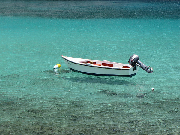 This boat was moored near the ship.  The water was amazingly clear and blue.