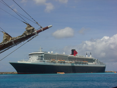 The QM2 left St. Kitts after us, but beat us to Barbados