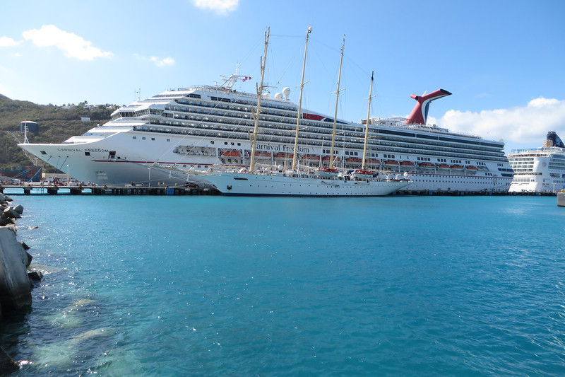 There are three ships on the other pier - Carnival Freedom, Norwegian Gem, and Star Clipper.